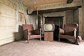 Old comfy chairs and TV left in living room