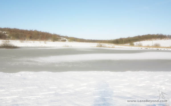 Snow and frozen pond