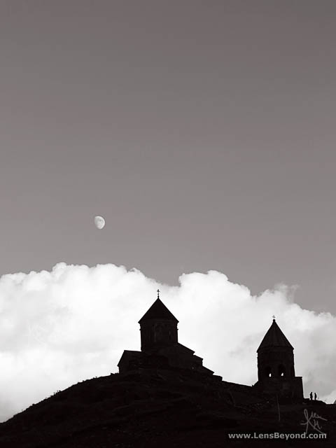 Gergeti Trinity Church silhouette and moon (black and white)