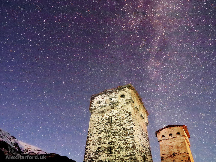 Svan towers backed by a snowy mountain and stars