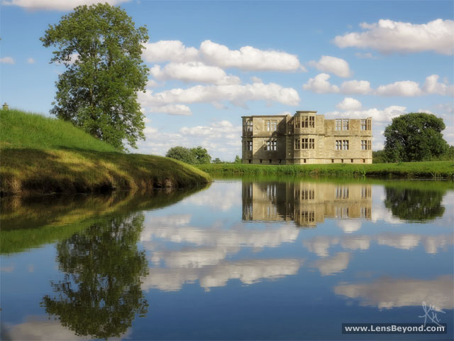 Blue skies with a photogenic view of a reflected Lyveden New Bield