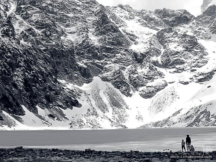 Black and white photo of a frozen Zarny Staw Pod Rysami (Black Lake below Mount Rysy), Tatra Mountains