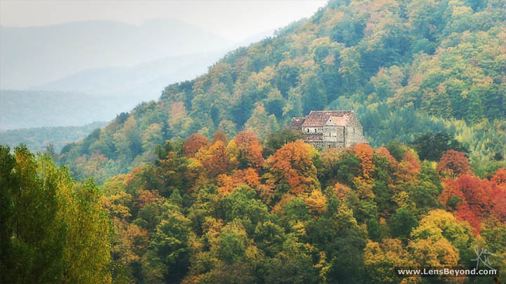 Photo of Cisnădioara's Fortress Church and Cibin Mountains in autumn, by Alex Harford