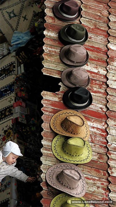 Photo of baby browsing market stall, Sighişoara