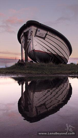 Boat reflection at sunset