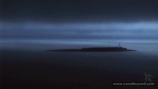 Pladda Lighthouse and island in silhouette at dawn