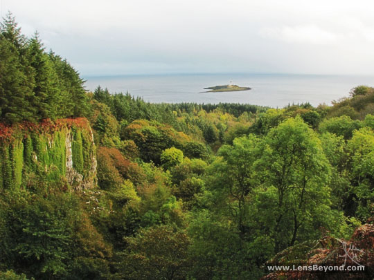 Pladda Lighthouse with autumn forest and the Irish Sea