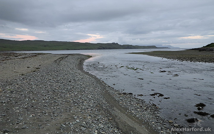 Pebbly beach at sunset, with river flowing into Loch Brittle