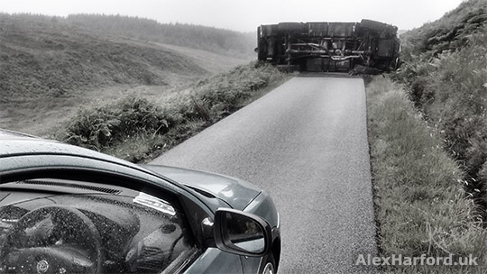 Vehicle on its side blocking single-track road between Elgol and Broadford