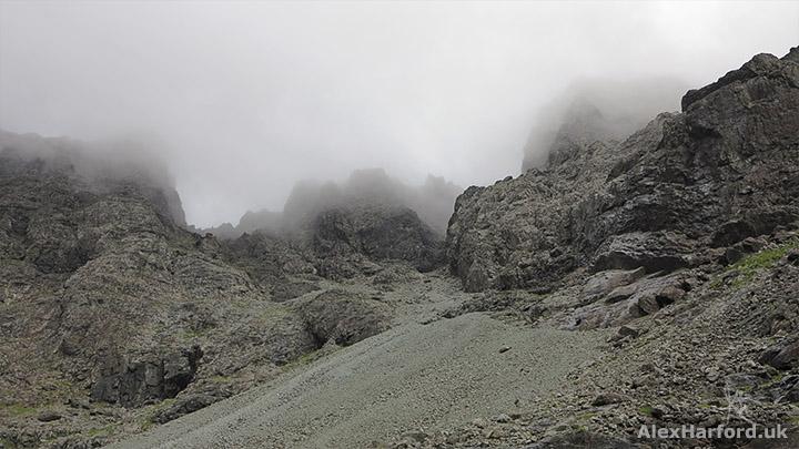 Black gabbro rocks beneath Sgùrr Alasdair's summit in cloud