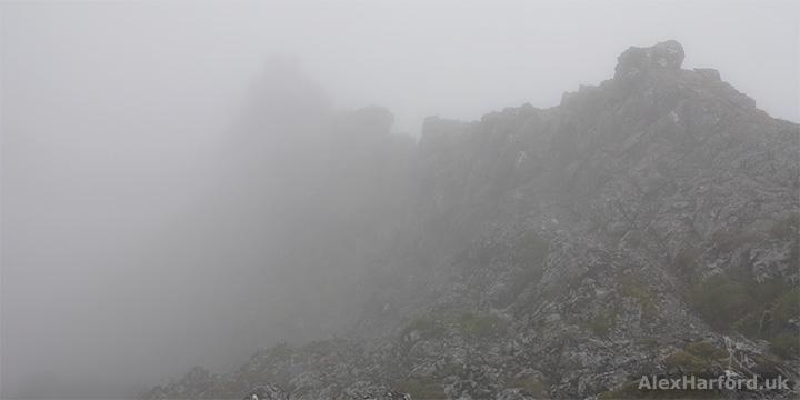Sgùrr Alasdair's rocky summit hidden by cloud