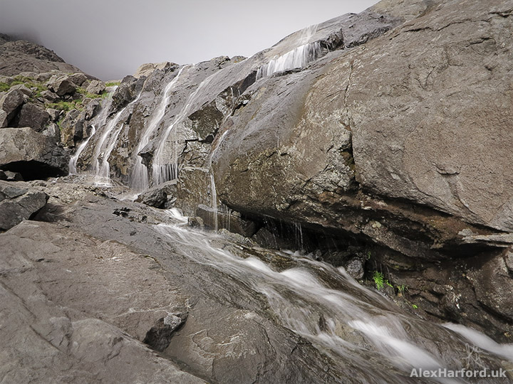 Waterfall over rocks on Sgùrr Alasdair's slope