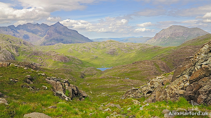 Grassy slopes lead to the mountains of Sgurr nan Gillean and Marsco and Ruadh Stac rising either side of Glen Sligachan