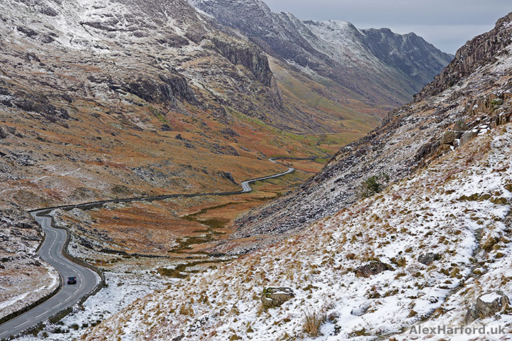 A4086 road winds through Pen-y-Pass between snow-covered mountains