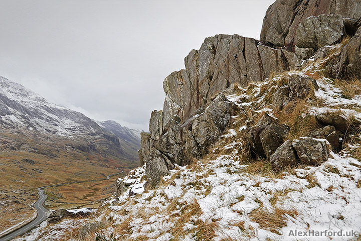 Looking down from Gorphwysfa's grey rocks to the A4086 at Pen-y-Pass