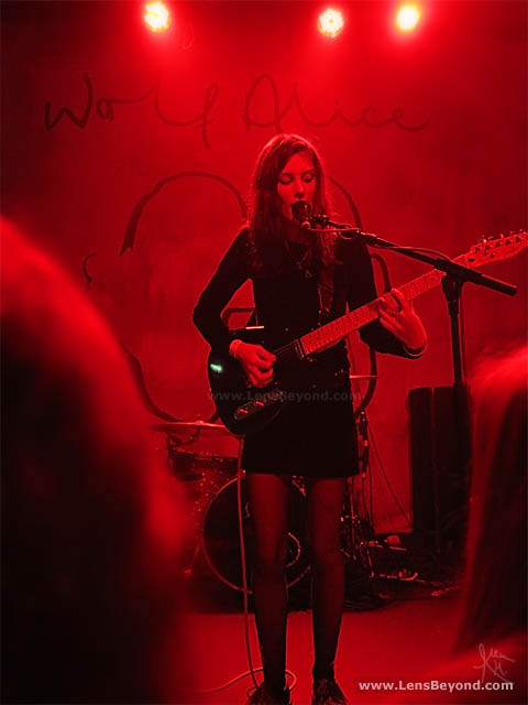Ellie Rowsell, Wolf Alice frontwoman, lit in red